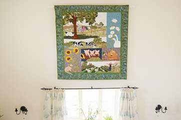 The Owner of Dowstall is an avid quilter and this lovely quilted and appliqued hanging shows the history of the farm.