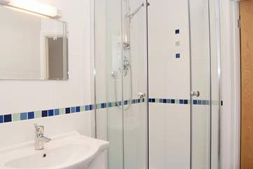 The spacious corner shower in the en suite to Bedroom 1.