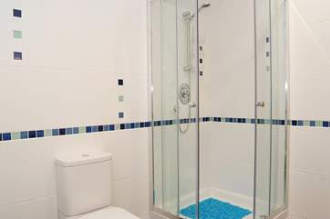 The family bathroom also has a spacious corner shower cubicle.