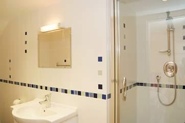 This shower-room is en suite to Bedroom 4.