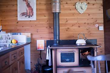 A log-fired range for your cooking and heating although there is gas stove on the front deck with two rings and grill too.