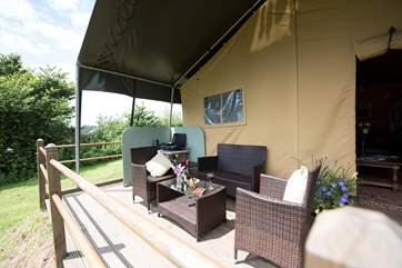 The deck at the front of the tent is a great place for al fresco eating - or for sharing a good bottle of wine and soaking up the views.