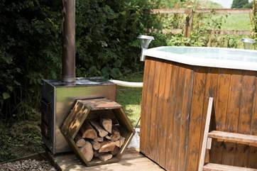 Enjoy lighting the stove and heating the water for an open-air hot tub experience. A large basket of logs can be purchased from the owner for £5.