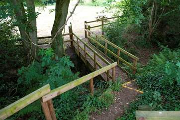 These wooden steps lead from the glamping site down to the lower meadow which has an enclosed play area, lake and network of footpaths beyond.