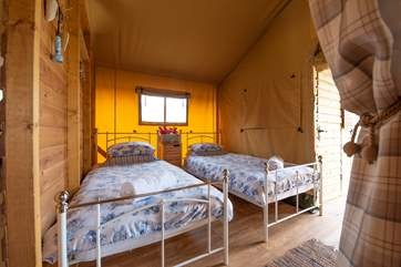 The second bedroom has cosy twin beds.