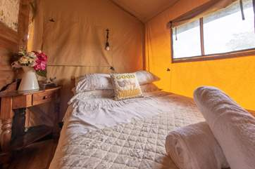 The pretty bedrooms are located at the back of the tent.