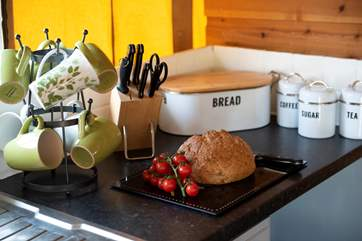The kitchen is well-equipped, with all you could need for your luxury glamping holiday.