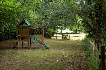 There is an enclosed play area in the lower meadow.