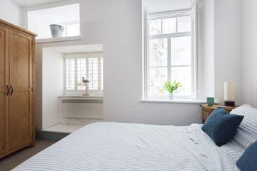 The bedrooms are to the rear of the apartment but the double aspect windows bring in the light.