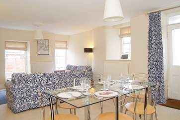 The sitting/dining-room is unexpectedly light and spacious for a Cornish cottage.