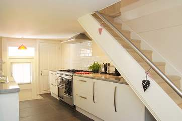 The galley kitchen is fully equipped. The cottage stairs are not too narrow or steep but there is only a small rail, so please take care with children.
