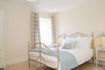 Bedroom 1 is calm and relaxing in shades of cream and duck-egg blue.