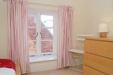 The big window in Bedroom 3 lets in plenty of light.