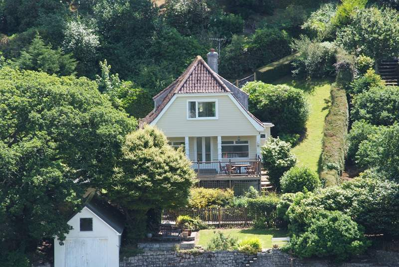 Helford House sits on the banks of this tidal river and you can spot the last section of the path down to the house with the rope railing (top right of the photo).