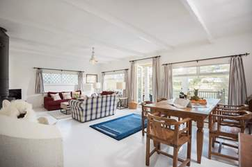 The living-room is spacious with room to relax and a choice of eating inside or out on the deck.