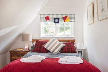 Bedroom 2 is furnished with a standard double bed and is opposite bedroom 3 across the landing with the bathroom next door.
