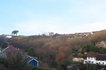 Sea View enjoys an enviable position (centre of photo) within walking distance to the village and pub, its downhill all the way there!