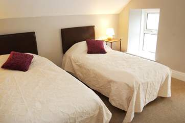 Two of the single beds in the loft room can be joined to make a good-size double bed.