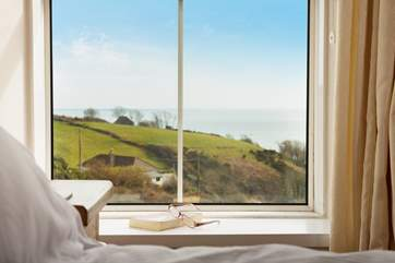 The view from the first floor double bedroom window can be seen from the bed, who needs a book or magazine.