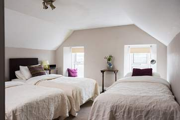 This room has 'zip and link' beds and a further single bed for flexibility.