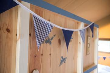 Bunting and stencils to coordinate the colour scheme.
