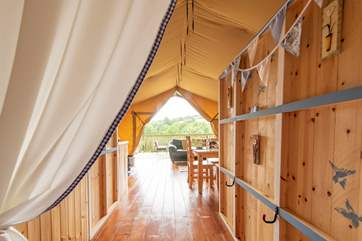 Looking back through, past the cabin bed, to the living area and deck beyond.