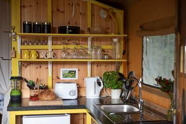 Celandine's kitchen-area complete with hot and cold water to the kitchen sink, an electric kettle, toaster and a fridge/freezer!