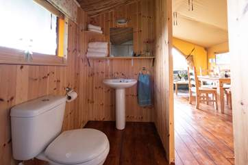 The spacious shower-room has a WC and wash-basin.