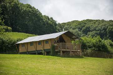 Campion at the far side of the meadow. The large covered balcony is a great place to relax and enjoy the peace of the countryside. The Owners have thoughtfully provided a camping gas stove for cooking