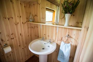 The spacious en suite shower-room with WC and wash-basin and double size shower.