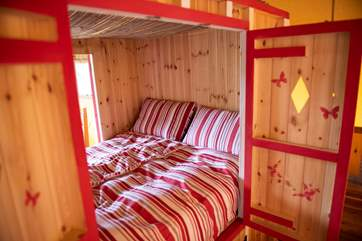 The den bed has doors on both sides and plenty of storage space underneath.