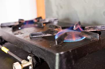A double gas hob for cooking to supplement the log-fired stove.