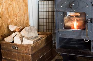 Logs are included for the log-fired stove.