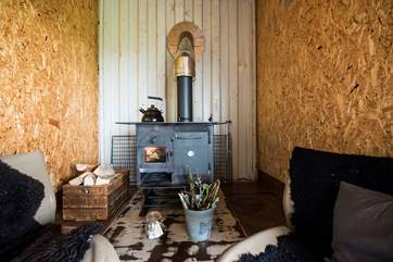The cosy sitting-area with log-fired range to keep you toasty and warm in the cooler months (and your cooker too!).