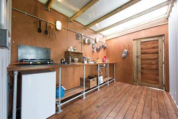 The kitchen is fully equipped including a kitchen sink!