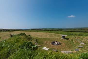 As well as the seven acre meadow, there is a further five acre meadow with fabulous sea views and the shared fire-pit for your use.