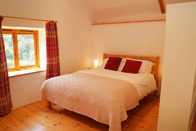 The bedroom is furnished with a five foot king-size bed.