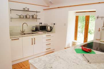 The large kitchen space is very well-equipped and has beautiful granite work surfaces.