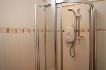 The shower-room has a large cubicle.