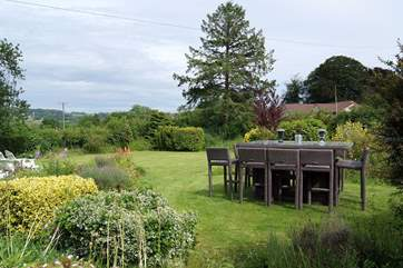 There is a huge enclosd garden here, with views across the meadow next to the farmhouse to the countryside beyond.