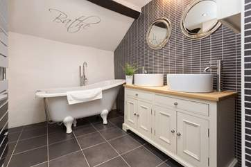 The family bathroom has a wonderful slipper bath as well as a separate shower.
