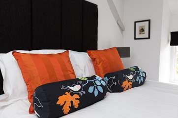 With touches of colour to add friendly warmth to the room