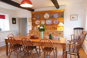 The dining room has an antique farmhouse dining table and dresser to add authentic character to this lovely room.