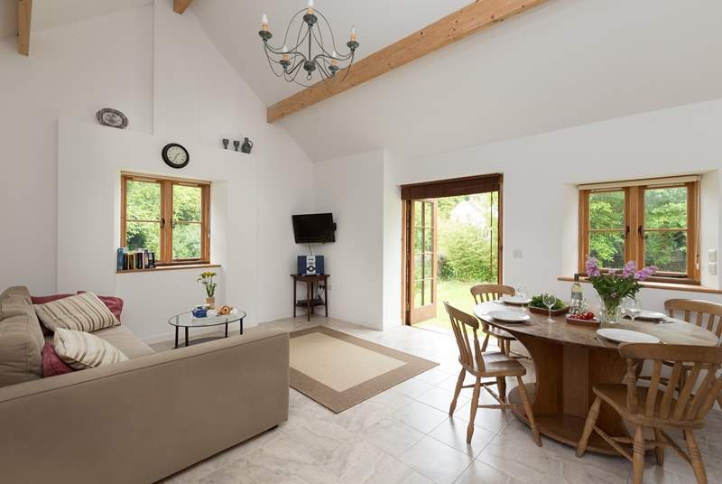 The Barn has a spacious open plan living area, with the kitchen in one corner and a large dining table in case you have guests to visit for a meal.
