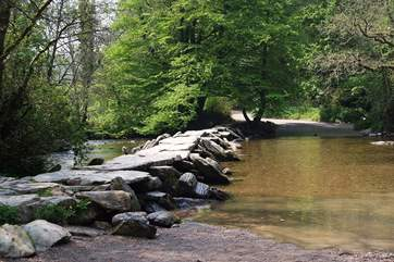 Visit the ancient Tarr Steps close to Dulverton. This historic clapper bridge is an iconic landmark in this beautiful National Park