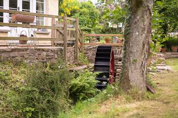 A little stream runs past the front of the cottage - complete with a water wheel.