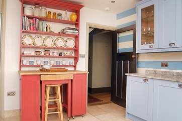 The kitchen leads to the hallway.