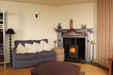 The sitting-area has a roaring wood-burner.