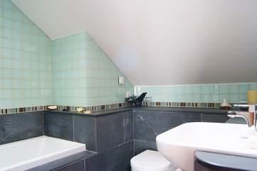 The en suite bathroom to Bedroom 4.