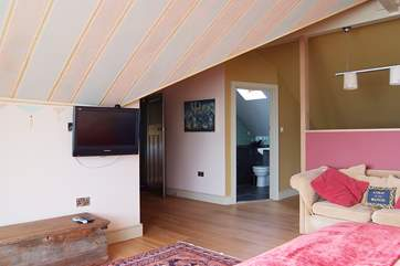 Bedroom 4 is spacious with a television equipped with NOW TV and en suite bathroom.
